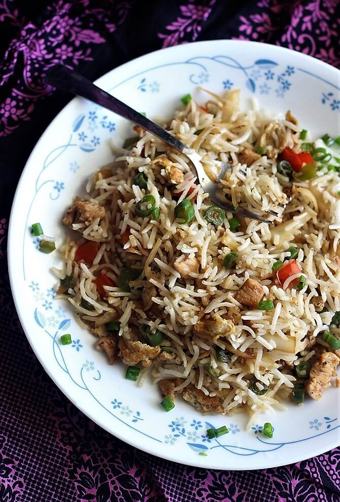 overhead view of easy chicken fried rice recipe in a plate with a fork