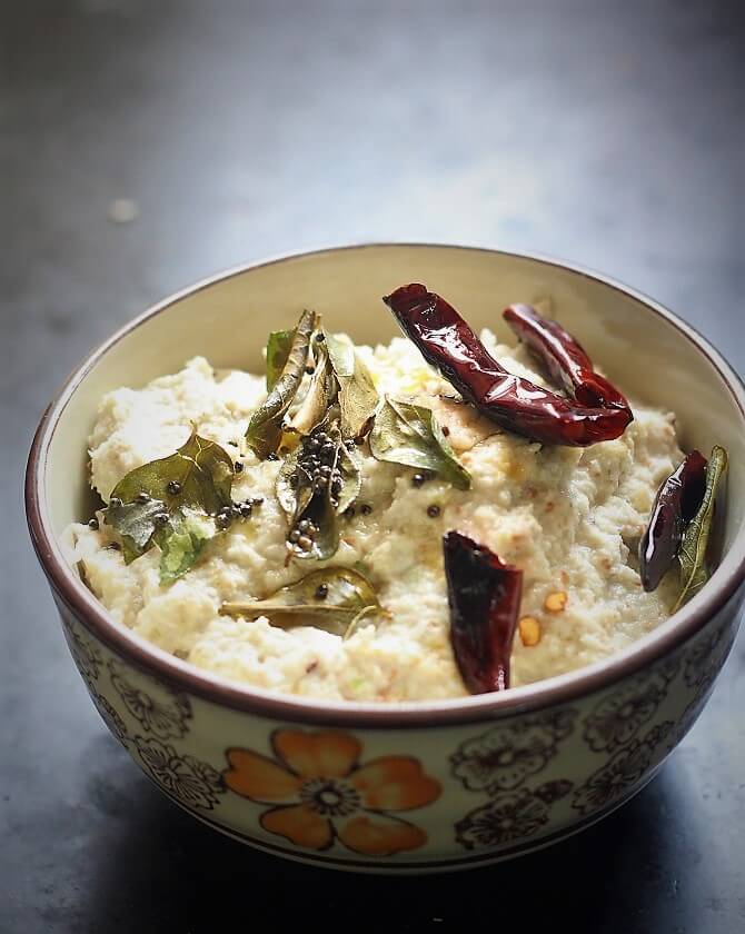 side view of peanut coconut chutney in a bowl