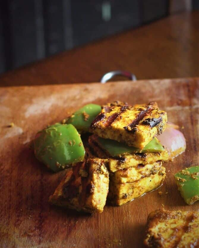 tandoori paneer tikka recipe on a wooden board