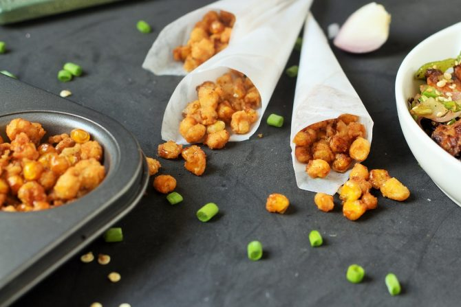 crunchy corn nuts served in small paper pockets