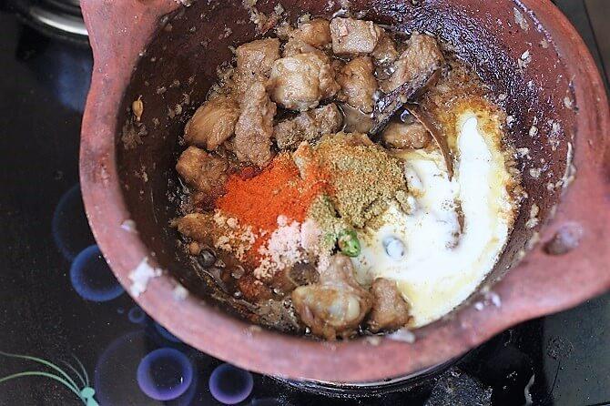 spices, yogurt being added to mutton masala recipe