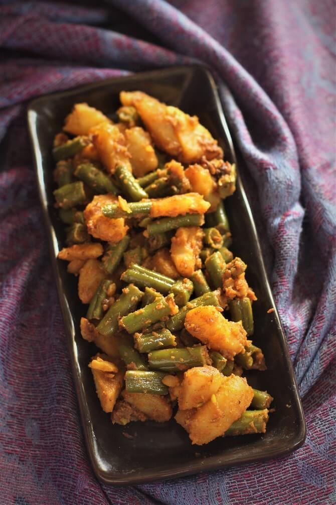 aloo beans sabji recipe in a rectangular plate