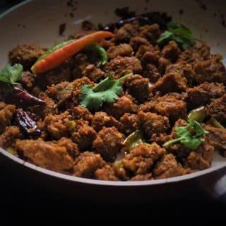side view of achari mutton recipe