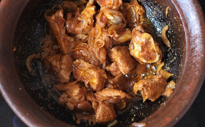 mutton getting cooked in a clay pan
