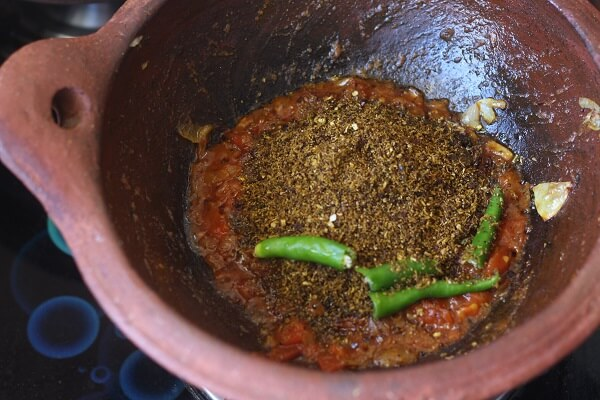 spices, green chili for chettinad egg curry in a clay kadai