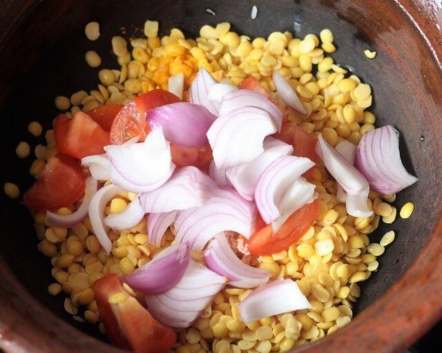 dal, tomato, onion in a clay pot