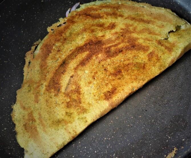 andhra pesarattu dosa recipe getting cooked