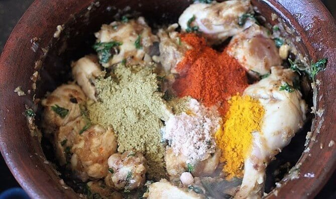 spices getting mixed with chicken