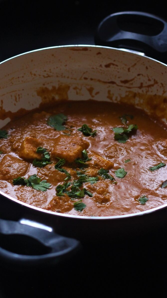 side view of paneer lababdar recipe in a white pan