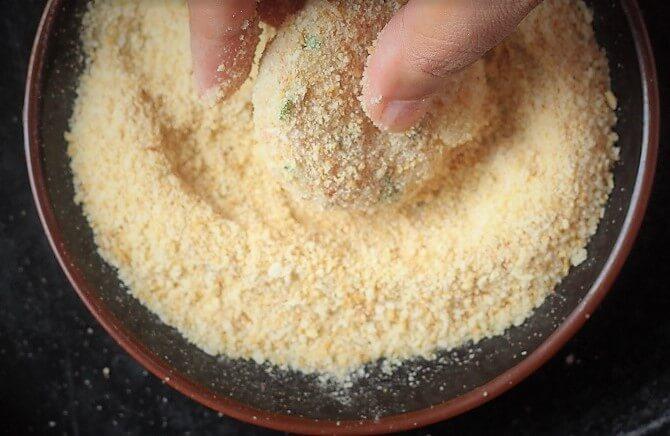 coating tikki with breadcrumbs