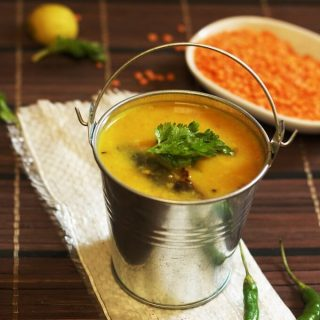masoor dal recipe served in a small bucket with red lentils in the background
