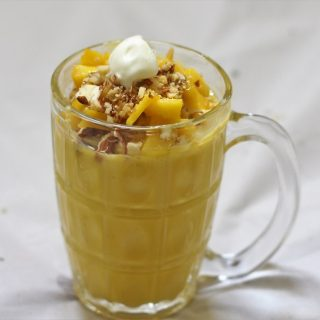 Mango Mastani recipe is a famous mango delicacy that is serve with a dollop of ice cream. This is a very simple preparation and gets ready in no time at all.