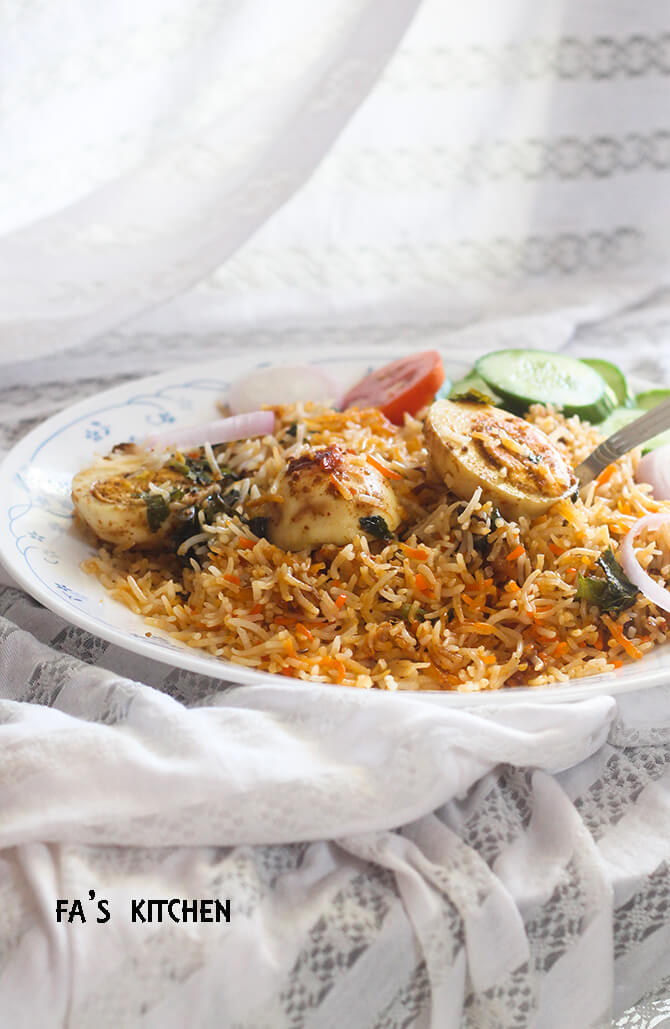 egg dum biryani on a plate with white background