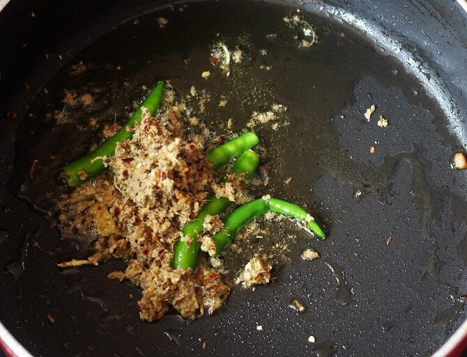 spice paste, green chili fried in a black pan for egg dum biryani