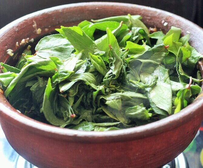 adding gongura leaves to the masala